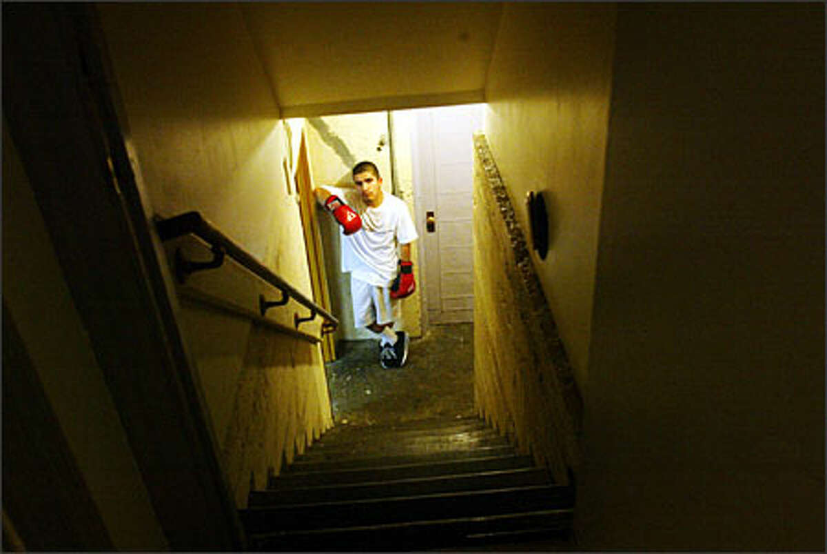 Boxer Randy Gomez stands at the bottom of the stairs to the gym where he works out in South Park. He'll participate in Golden Gloves state championship matches in Tacoma in mid-February.