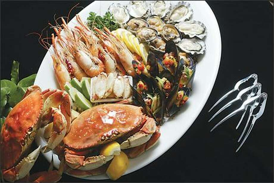 Are you kidding? No defense can stop this crack starting lineup of Dungeness crab, crab legs, mussels, clams, oysters and prawns. These crustaceous beauties are courtesy of the Oceanaire Seafood Room. Photo: Karen Ducey, Seattle Post-Intelligencer / Seattle Post-Intelligencer