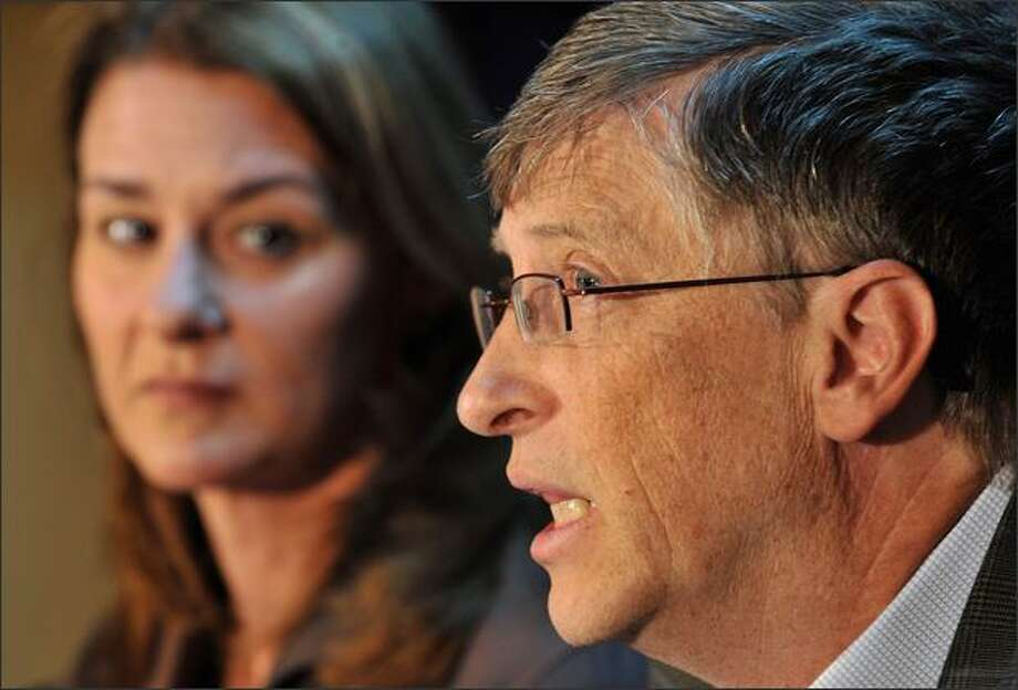 Bill Gates, former Microsoft chairman, and his wife, Melinda, left, are seen during a press conference on their charity foundation on Friday at the World Economic Forum in Davos, Switzerland. Photo: Getty Images / Getty Images