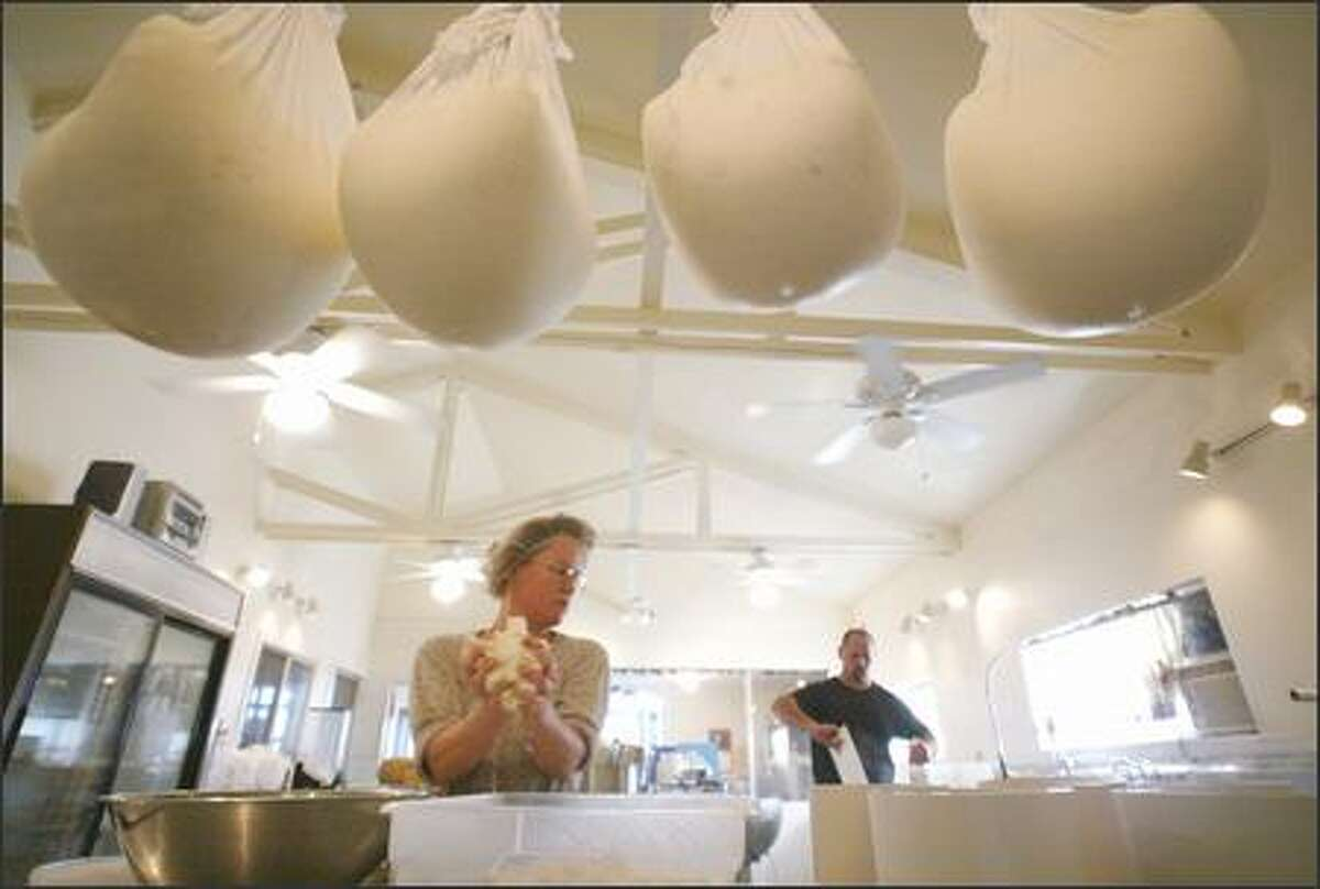 Kelli and Anthony Estrella make some of their Wynoochee River Blue at their Estrella Family Creamery in Montesano, 10 miles east of Aberdeen.