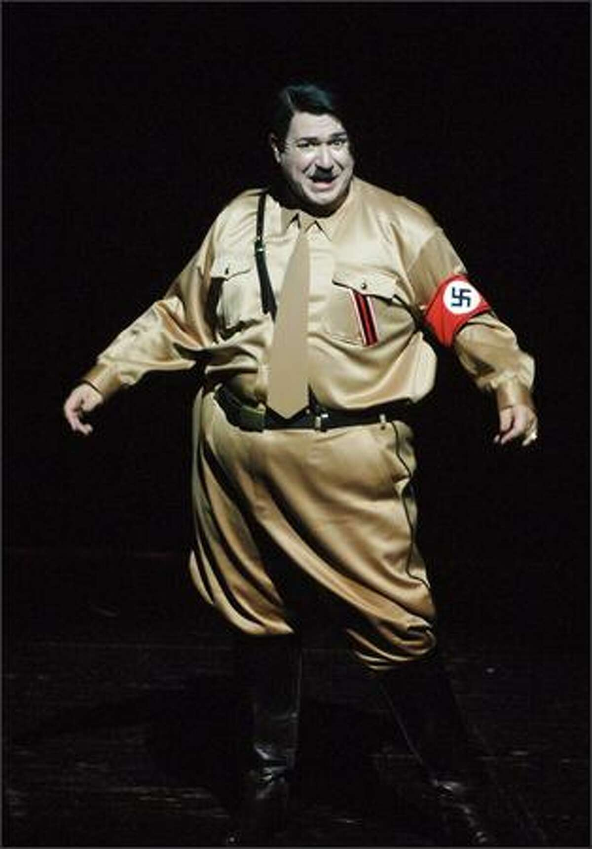 They said it couldn't be done, but they wuz wrong. A clownish Adolph Hitler (played by Itzik Cohen) hams it up in a production of
