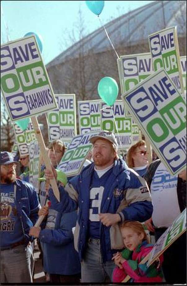 "David Wilson and his daughter, Katy, 6, take part in a ""Save Our Seahawks"" rally across from the Kingdome on Feb. 10, 1996. Photo: Seattle Post-Intelligencer / Seattle Post-Intelligencer"