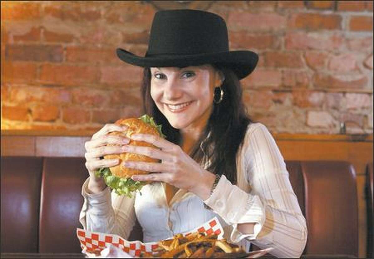 BalMar co-owner Andrea Martin loves to dig into one of the special burgers at King's Handware in Ballard.