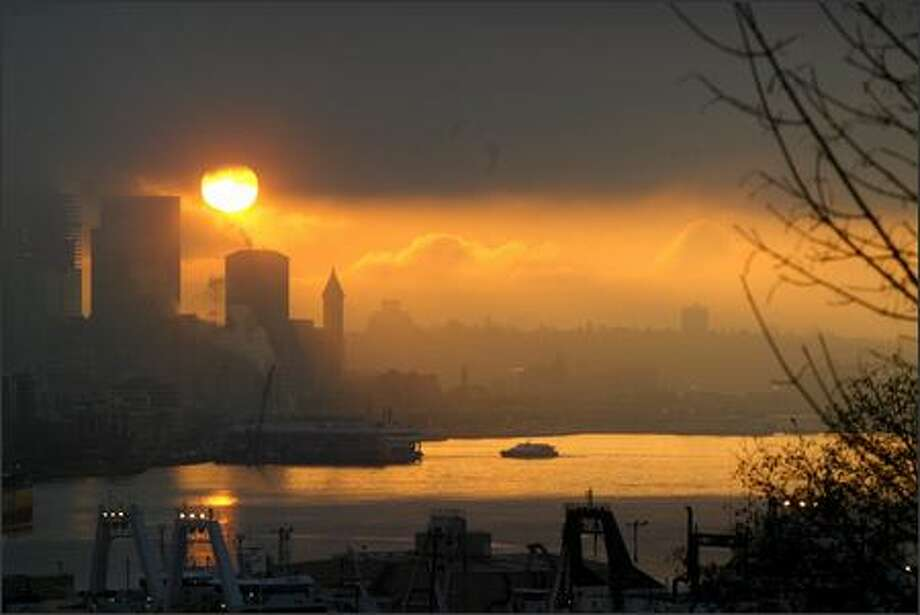 Seattle has been known on occasion to get smog, witness this picture of smog and fog over Elliott Bay during an early winter air inversion.  Photo: Phil H. Webber, Seattle Post-Intelligencer / Seattle Post-Intelligencer