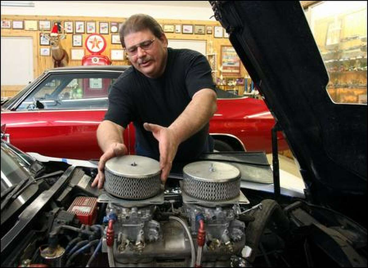 Perry Weaver works on a 1968 Corvette at the auto repair shop he opened last year in Concord, Mich., after getting laid off. But, like many, he's finding business tough.