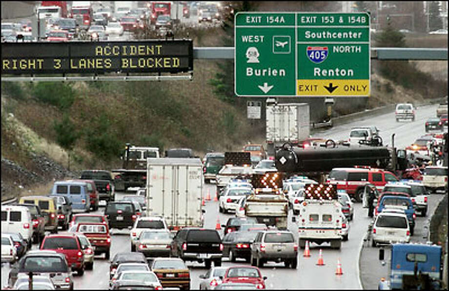 Interstate 5 at South 178th Street resembles a parking lot after several collisions in the northbound lanes. Friday's snarl occurred about 1 p.m. Photo: Dan DeLong, Seattle Post-Intelligencer / Seattle Post-Intelligencer