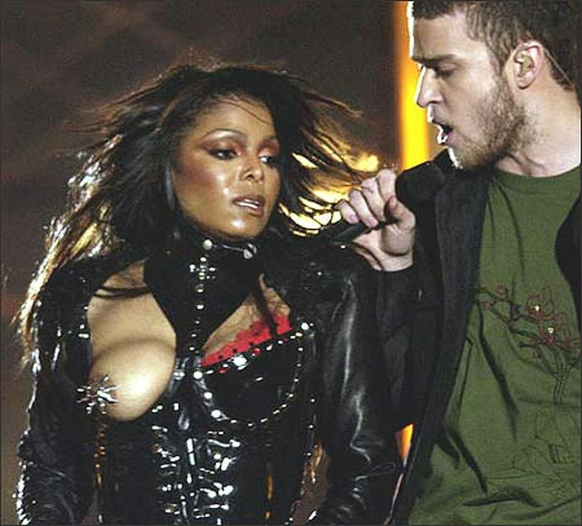 Entertainer Janet Jackson's breast is exposed after her outfit came undone during the halftime performance with Justin Timberlake at Super Bowl XXXVIII in Houston Sunday. (AP Photo/David Phillip)