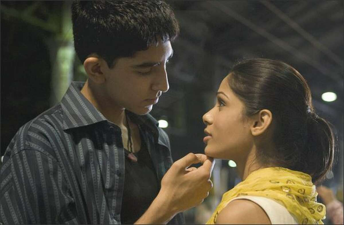 Dev Patel, left, and Freida Pinto are shown in a scene from