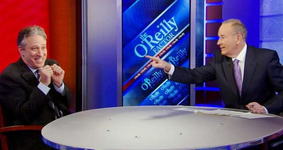 "In this image taken from video and provided by the Fox News, ""The O'Reilly Factor"" host Bill O'Reilly points across the table at ""Daily Show"" host Jon Stewart, on the set of the ""The O'Reilly Factor,"" Wednesday, Feb. 3, 2010 in New York. (AP Photo/Fox News Channel) Photo: Associated Press / Associated Press"