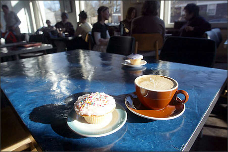 Cupcake Royale's creations are made without stabilizers, with real buttercream frosting, and baked fresh every day. Vérité's Coffee uses beans roasted fresh by Caffe Umbria. Photo: Karen Ducey, Seattle Post-Intelligencer / Seattle Post-Intelligencer