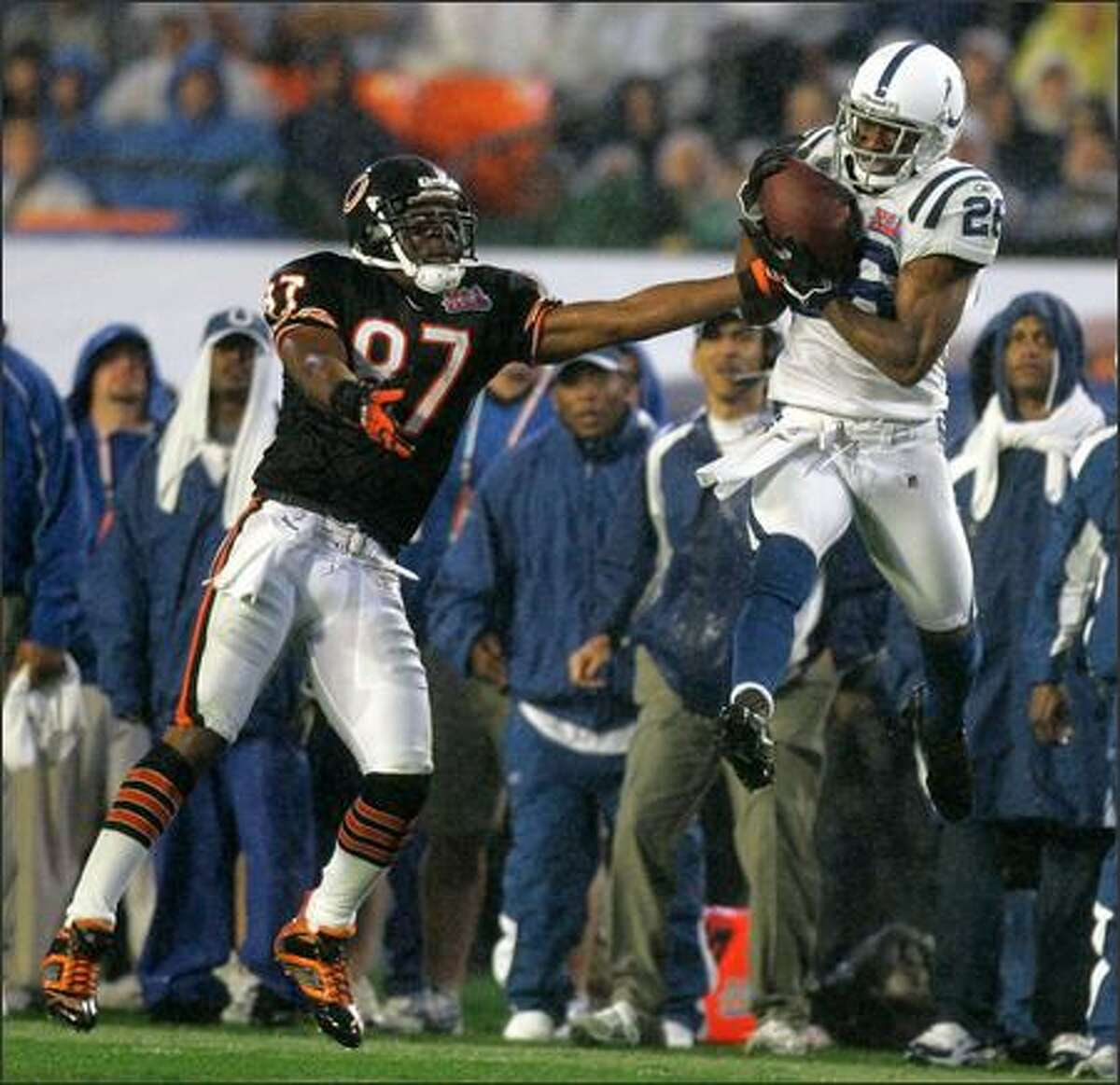 Indianapolis Colts cornerback Kelvin Hayden (26) intercepts a pass intended for Chicago Bears wide receiver Muhsin Muhammad (87) during the fourth quarter of Super Bowl XLI. (AP Photo/Jeff Roberson)