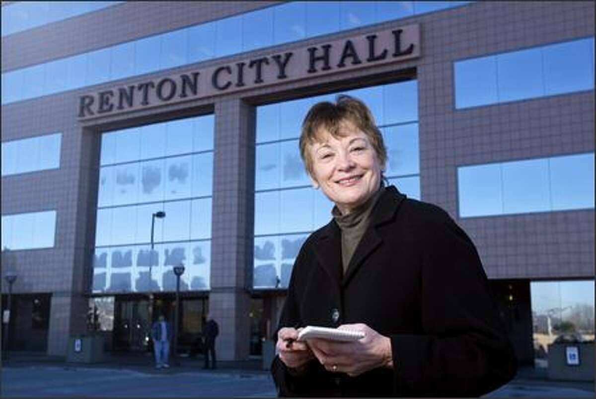 Mary Swift stands in front of Renton City Hall.