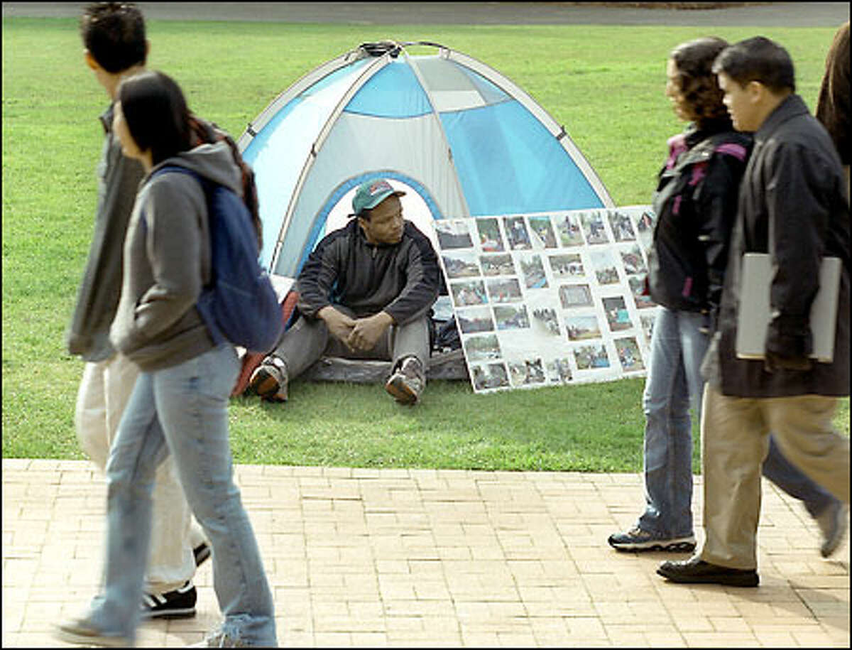 Tent City resident Eric Davis joins University of Washington students at a demonstration on homeless issues on the UW campus yesterday.