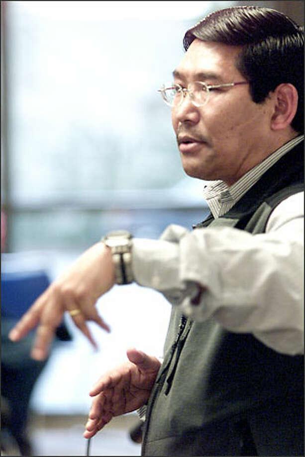 "Nawang Dorjee, Bellevue Community College scholar in residence, lectures recently on ""Tibet: Peaceful Activism."" Photo: Loren Callahan, Seattle Post-Intelligencer / Seattle Post-Intelligencer"