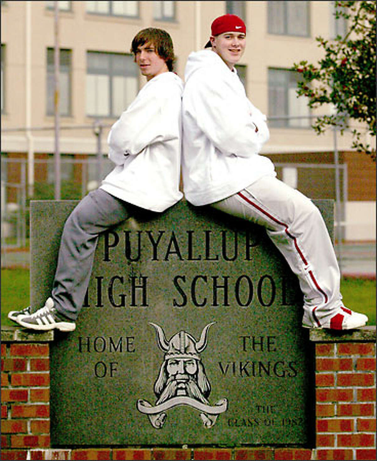 Puyallup kicker Loren Langley, left, and tight end Jacob McKinney were among 28 players to sign with WSU.