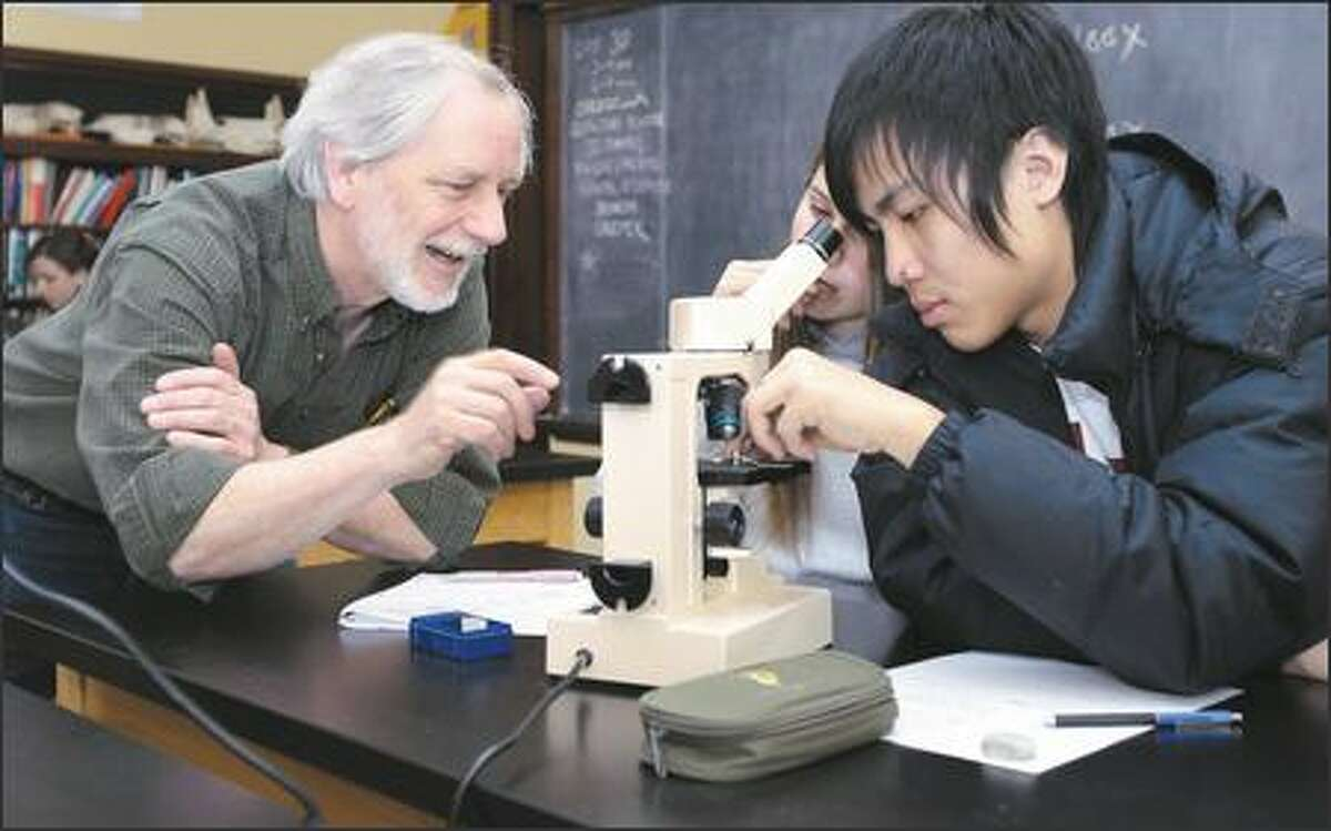 Mark Terry, co-founder and science department chairman of The Northwest School, is starting to teach his students, such as Ali Putnam and Dustin Lo, both 17, about intelligent design.