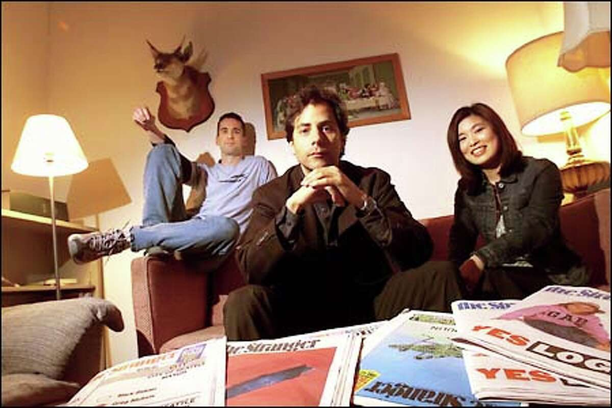 Stranger publisher Tim Keck, center, editor/columnist Dan Savage, left, and ad manager Laurie Saito in 2002.