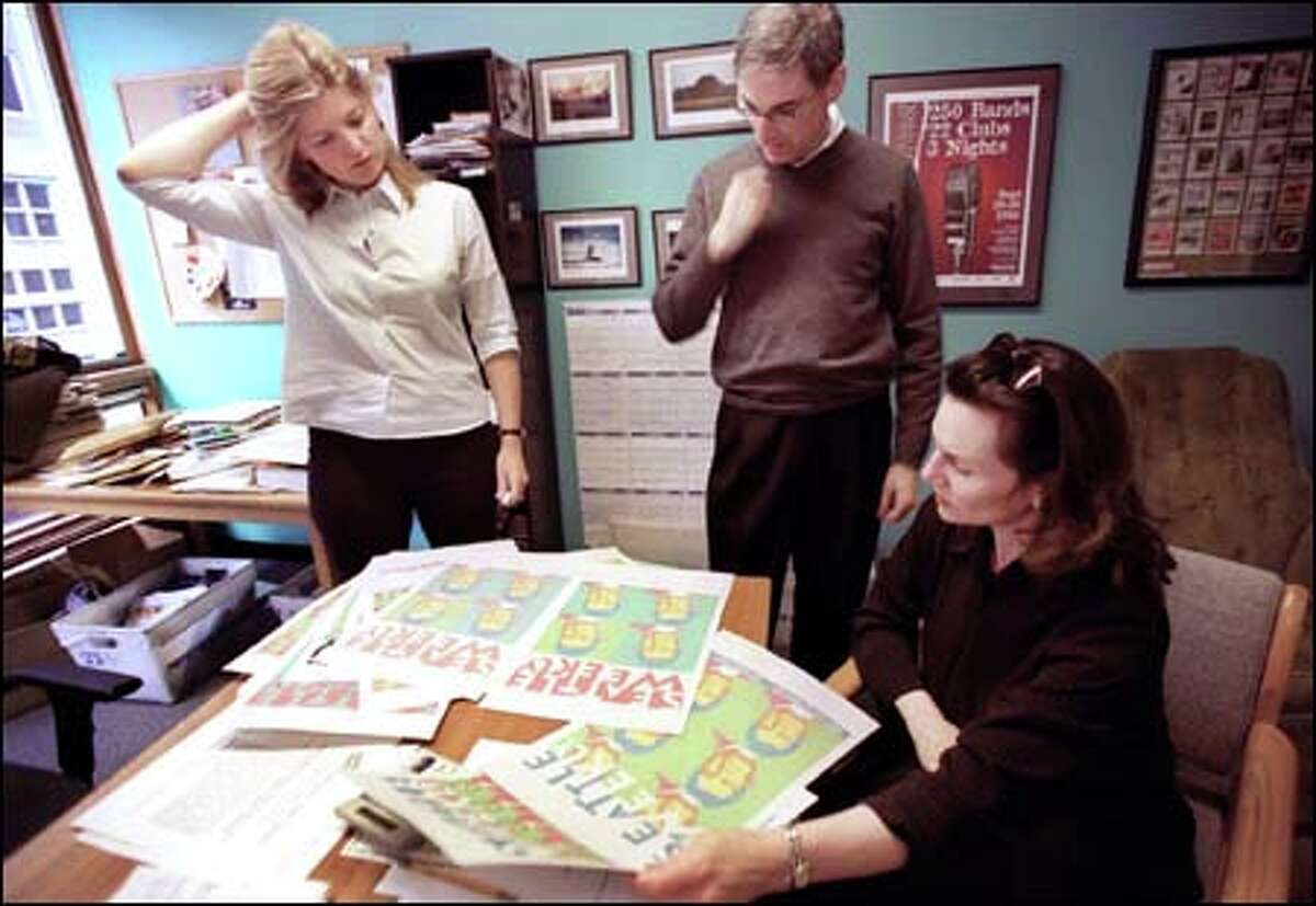Seattle Weekly owner David Schneiderman, center, editor Audrey Van Buskirk, left, and Dana Faust, associate publisher for sales and marketing, in 2002.