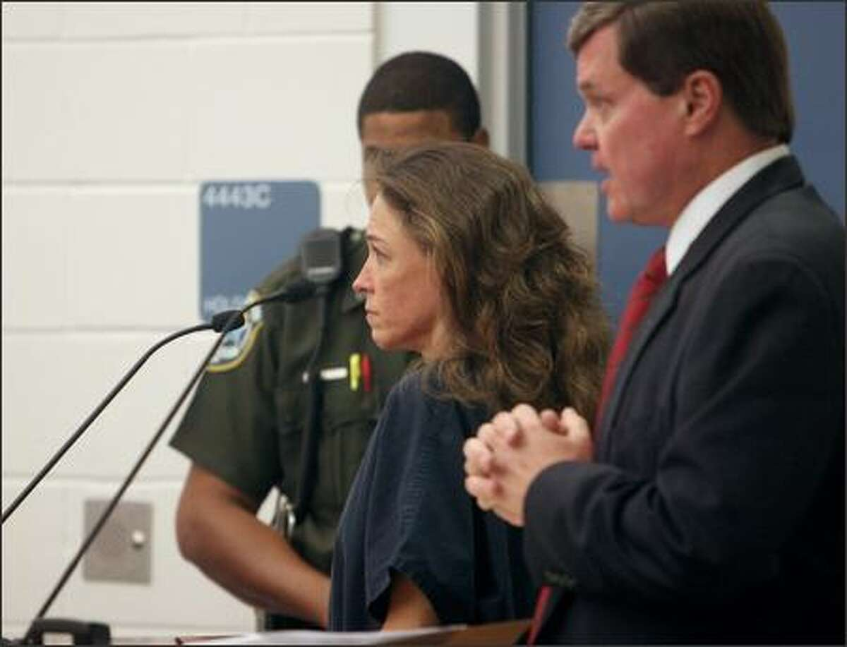 Astronaut Lisa Marie Nowak appears at a hearing in Orlando, Fla., Tuesday with her lawyer, Donald Lykkebak. She was later charged with attempted murder and released on bail.