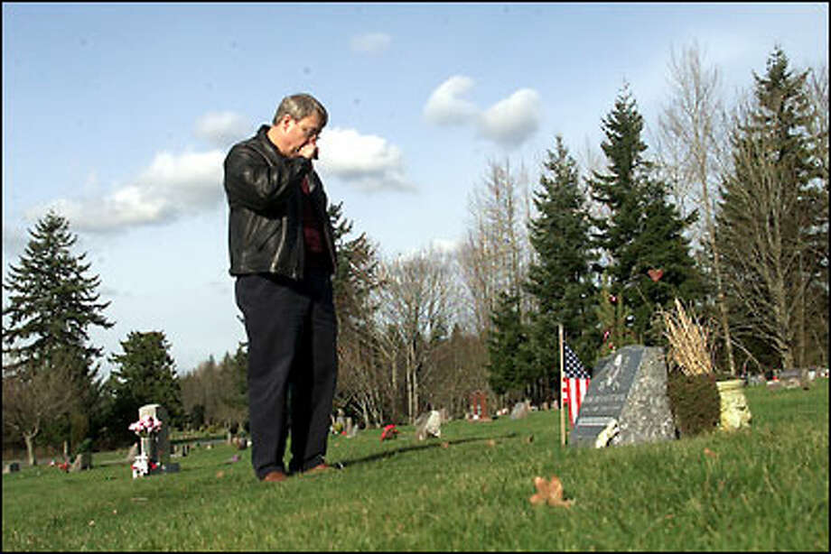 Frank King stands at the grave of his son Wade, who was killed in the 1999 Bellingham gas pipeline explosion. King is angry because the blast's precise cause is still unknown. Photo: Paul Kitagaki Jr., Seattle Post-Intelligencer / Seattle Post-Intelligencer