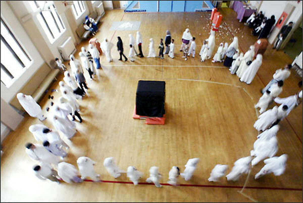 Students at the Islamic School of Seattle re-enact the hajj, or pilgrimage to Mecca, in their school gym.