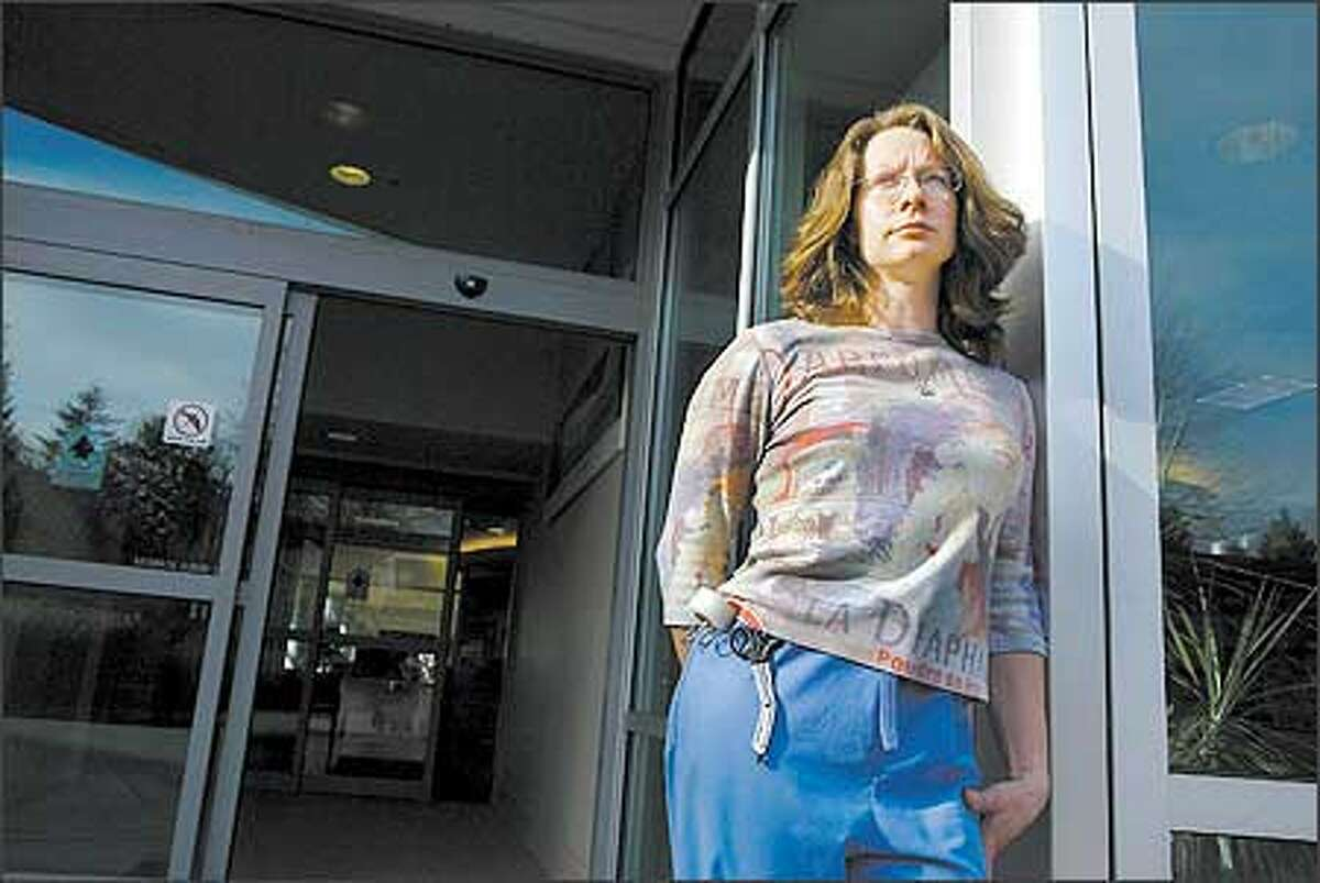 Kathleen Collins, 34, of Lake Stevens said she struggles to get by on the $21,000 she makes a year as an emergency-room technician.
