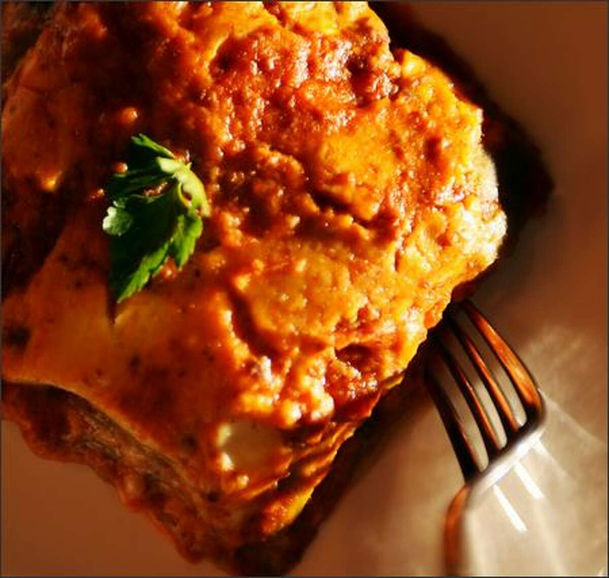 A satisfying lasagna is made with veil-thin sheets of noodle that encase a light béchamel and pure ragu.