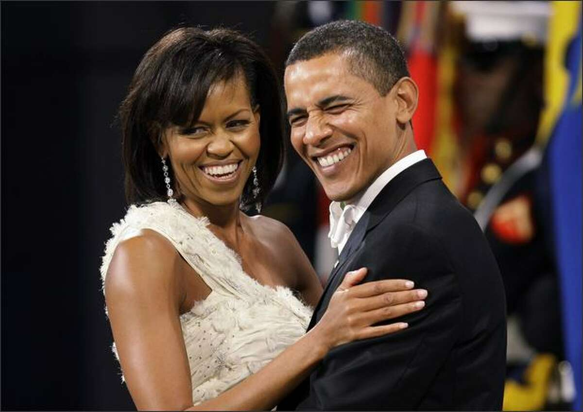 President Barack Obama and first lady Michelle Obama dance at the Obama Home States Inaugural Ball Jan. 20. Michelle Obama wore a one-shoulder gown by Jason Wu.