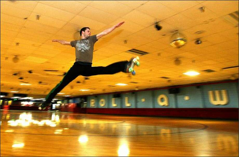 Josh Rhoads practices his routine at Lynnwood Bowl & Skate, where he also is a manager and teaches roller-skating. Rhoads is known in competitive skating circles for his artistry and grace. Photo: Mike Kane, Seattle Post-Intelligencer / Seattle Post-Intelligencer