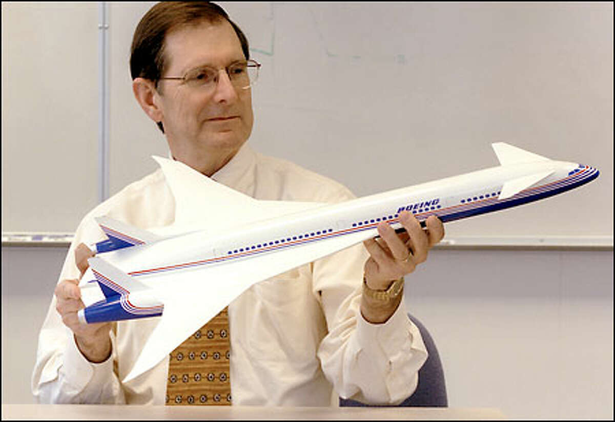 Walt Gillette, vice president and general manager of the sonic cruiser program at Boeing, displays a model of the plane, which could be an evolutionary leap in airline transportation.