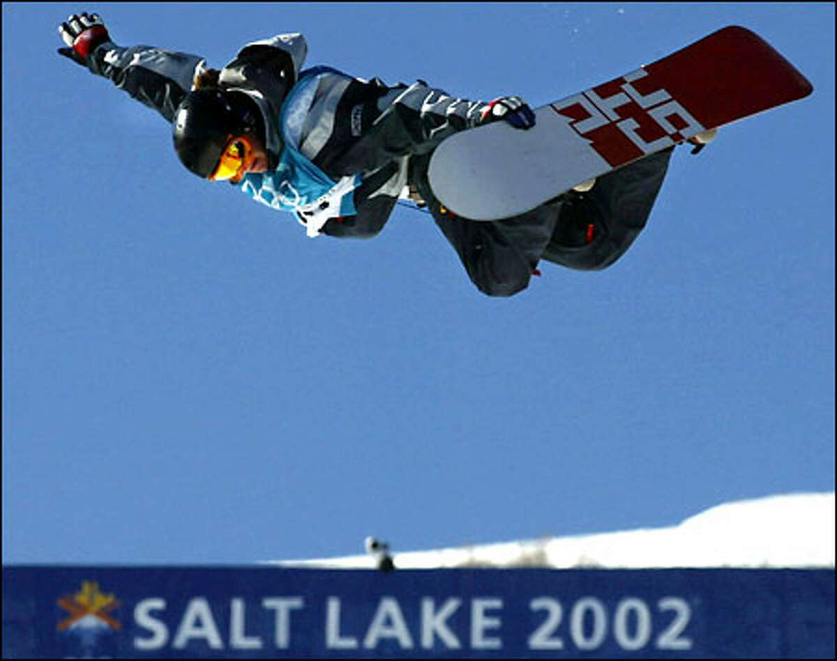 American Kelly Clark shows her form during the women's snowboarding halfpipe competition yesterday in Park City, Utah. The 18-year-old from Vermont soared higher than any of her competitors and easily won the first gold medal of the Games for the United States.