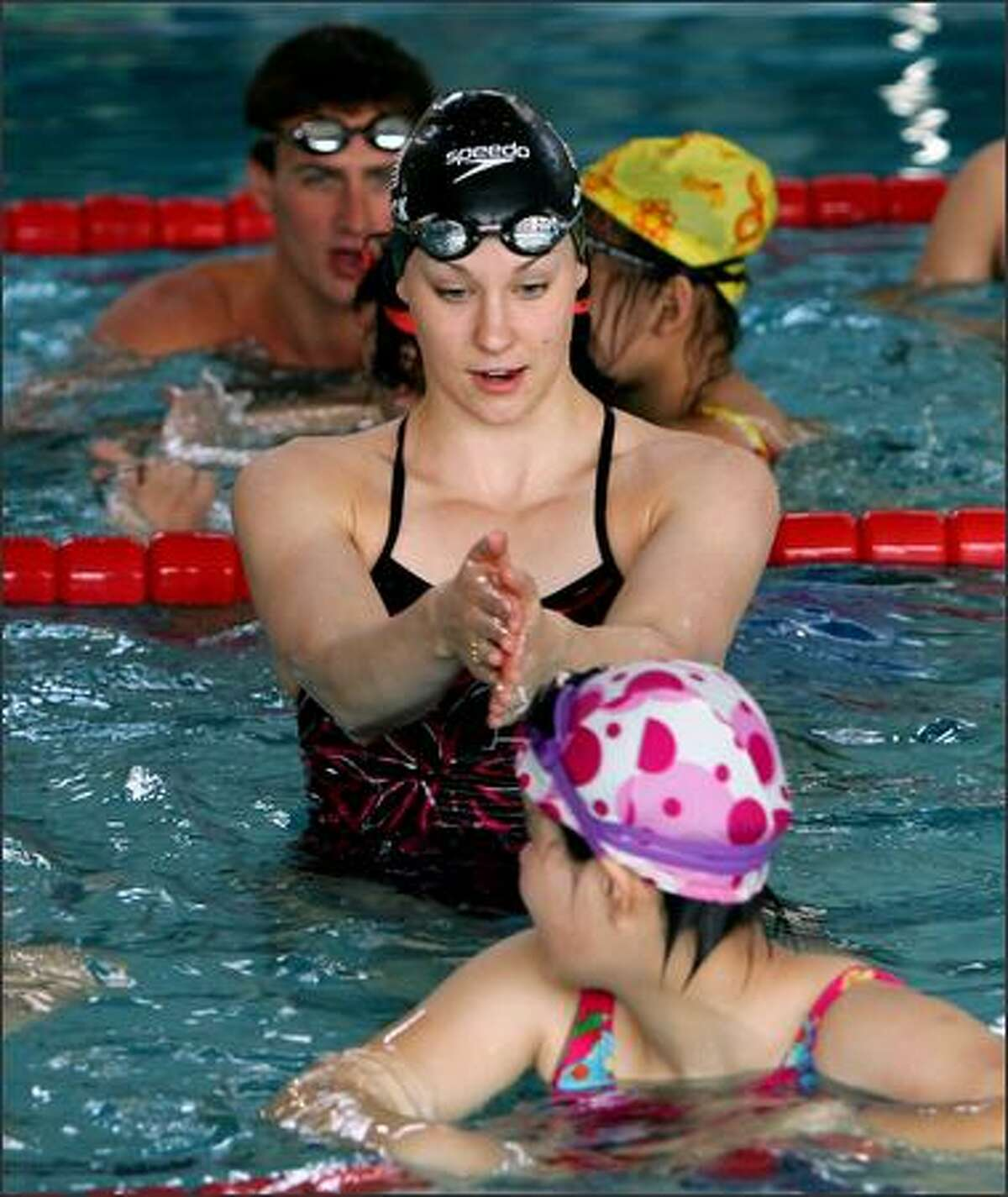 Megan Quann Jendrick instructs a Special Olympic swimmer during a swimming clinic at a school in Beijing during a goodwill trip to China in April 2007.