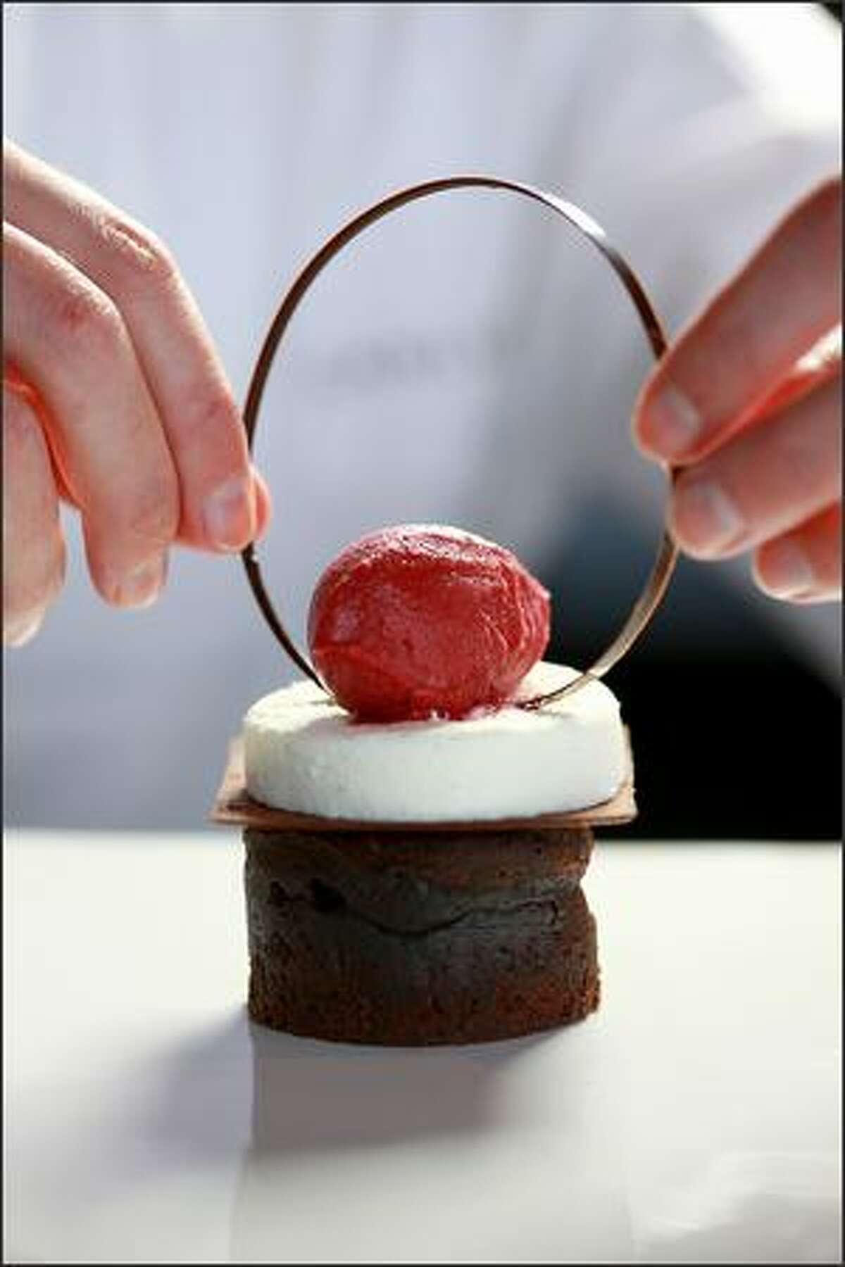 Molten Chocolate Black Forest Cake with Sour Cherry Sorbet, Kirsch Mousse and Thin Chocolate Tuile Cookie.