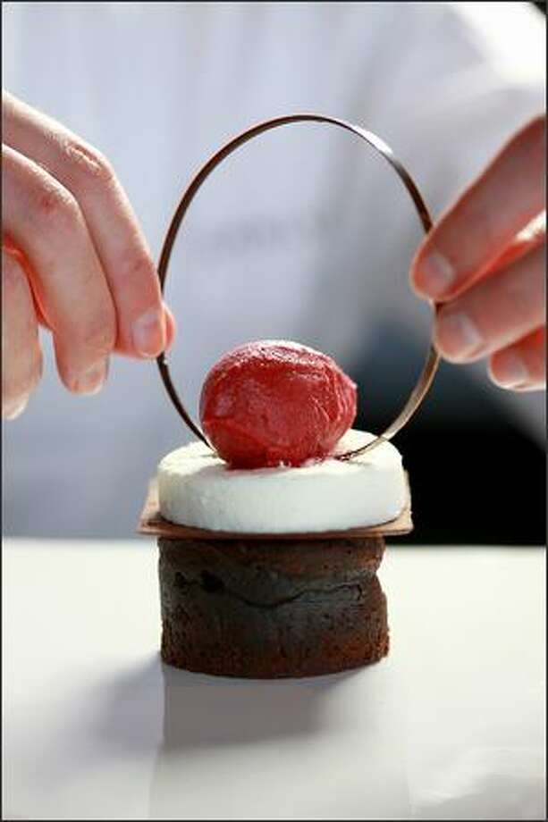 Molten Chocolate Black Forest Cake with Sour Cherry Sorbet, Kirsch Mousse and Thin Chocolate Tuile Cookie. Photo: Scott Eklund, Seattle Post-Intelligencer / Seattle Post-Intelligencer