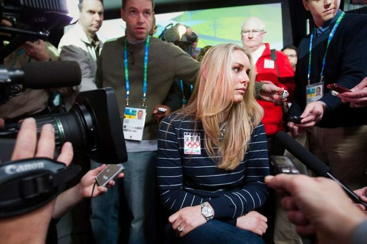 US alpine skier Lindsey Vonn is surrounded by media during a news conference in advance of the 2010 Winter Olympic Games on Wednesday, Feb. 10, 2010, in Vancouver. Vonn revealed that she sustained a shin injury in training that puts her participation in the games in question.