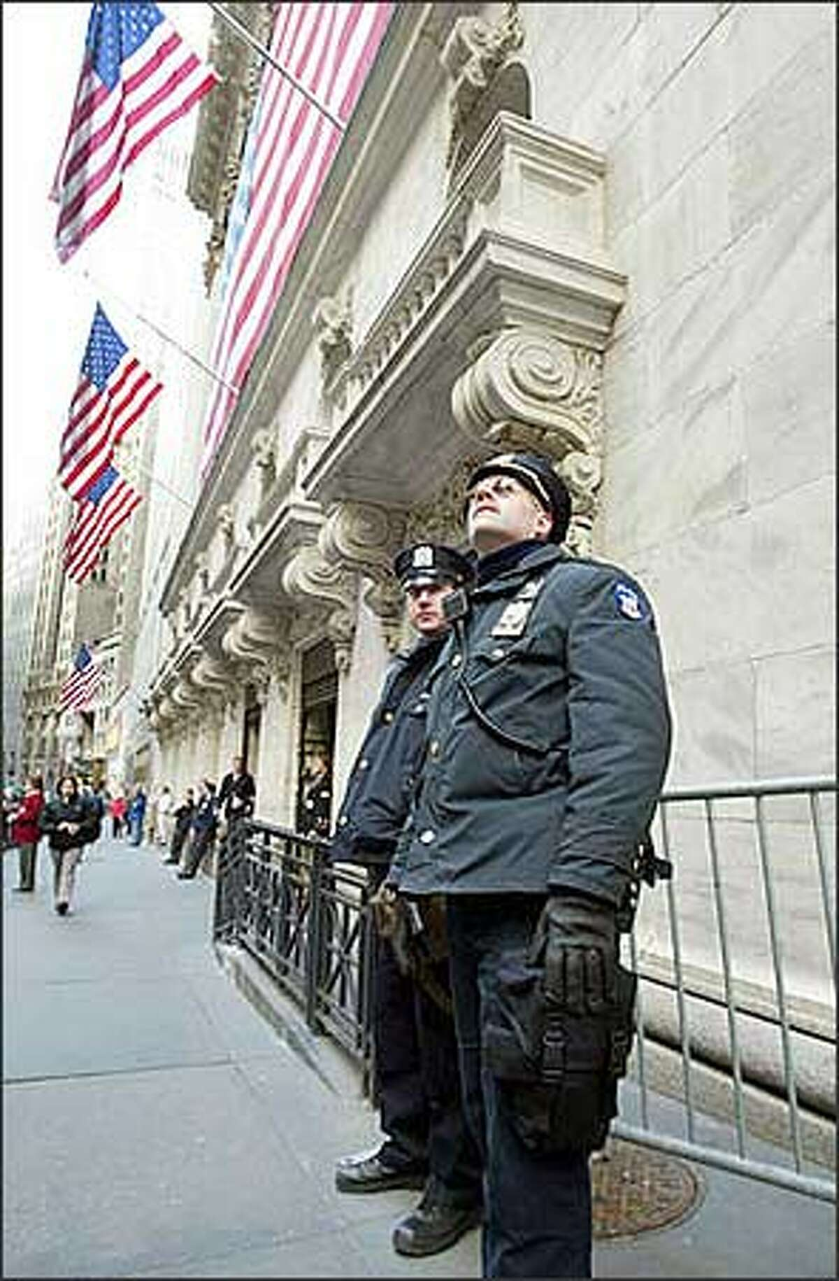 Police patrol outside The New York Stock Exchange Wednesday, Feb. 12, 2003. Police stepped up security at airports, subways and hotels and other public places after the nation was put on heightened terrorist alert and law enforcement officials indicated New York was a possible target. (AP Photo/David Karp)