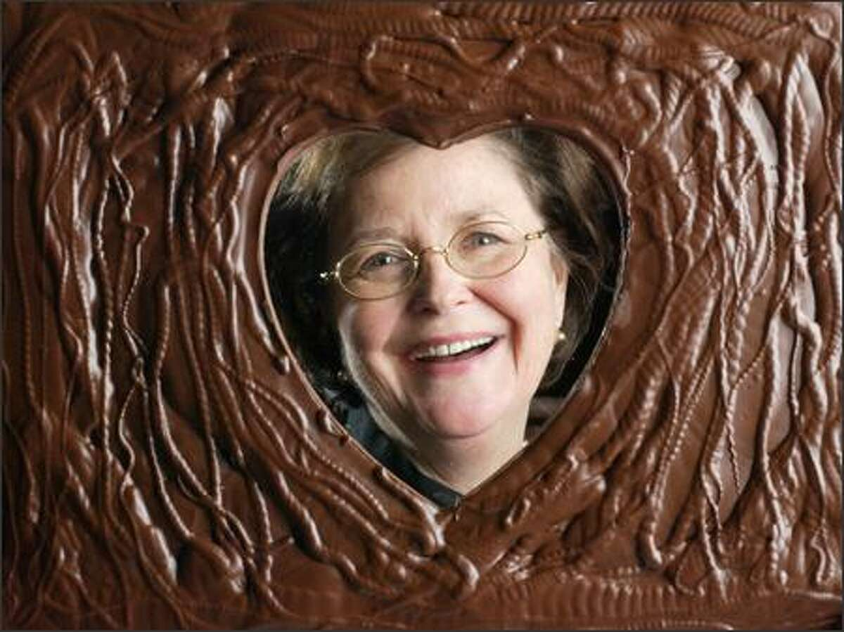 Fran Bigelow, president of Fran's Chocolates, is seen through a Valentine's Day-themed confection.