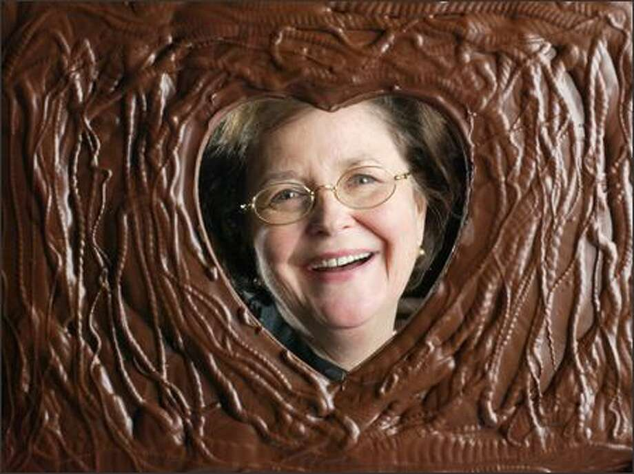 Fran Bigelow, president of Fran's Chocolates, is seen through a Valentine's Day-themed confection. Photo: Andy Rogers, Seattle Post-Intelligencer / Seattle Post-Intelligencer