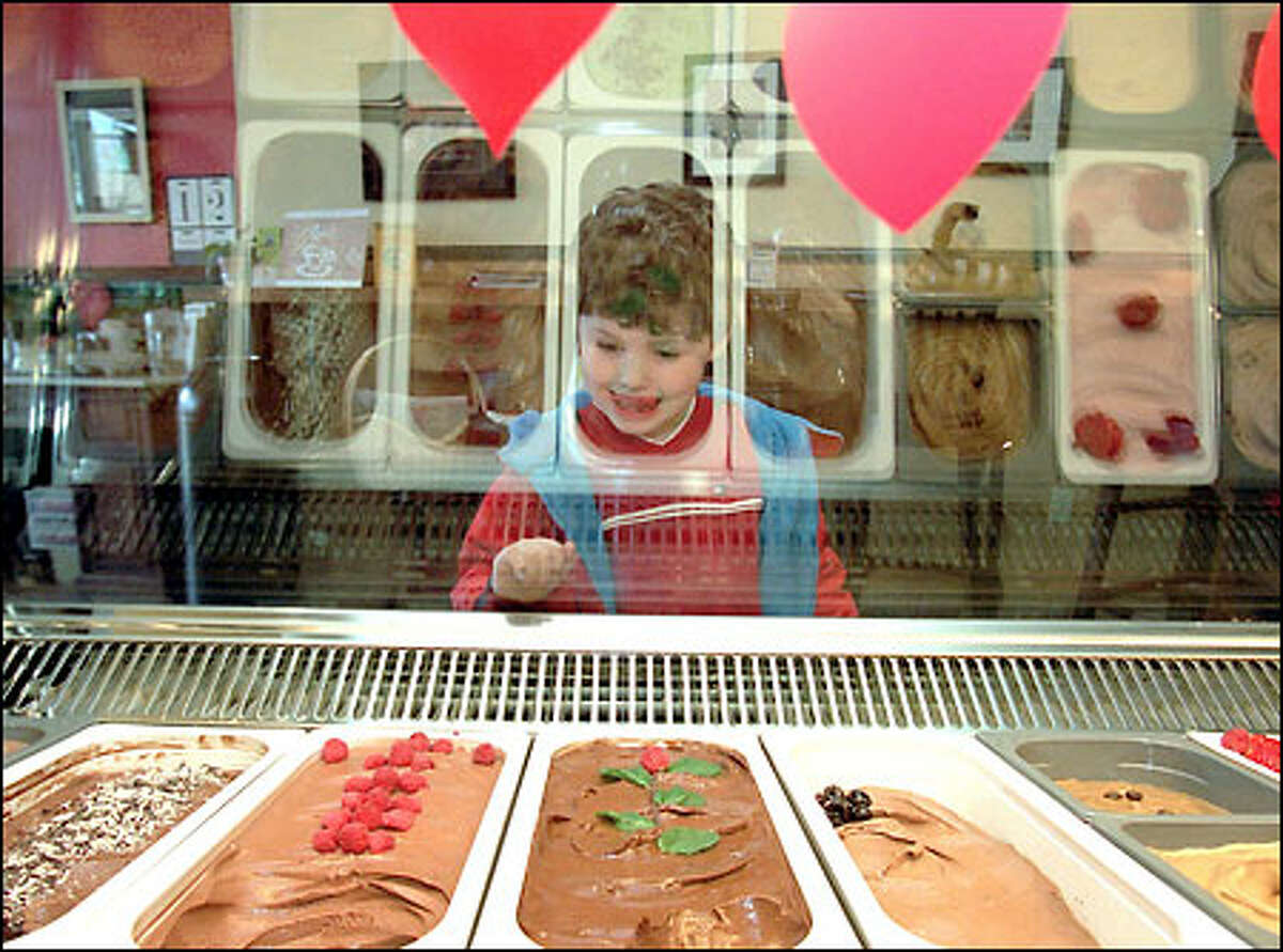 A taste of Italy ... Andrew Roger checks out the gelato at Dolce Vita, a cafe that James Lalonde opened on Queen Anne Avenue North in September.