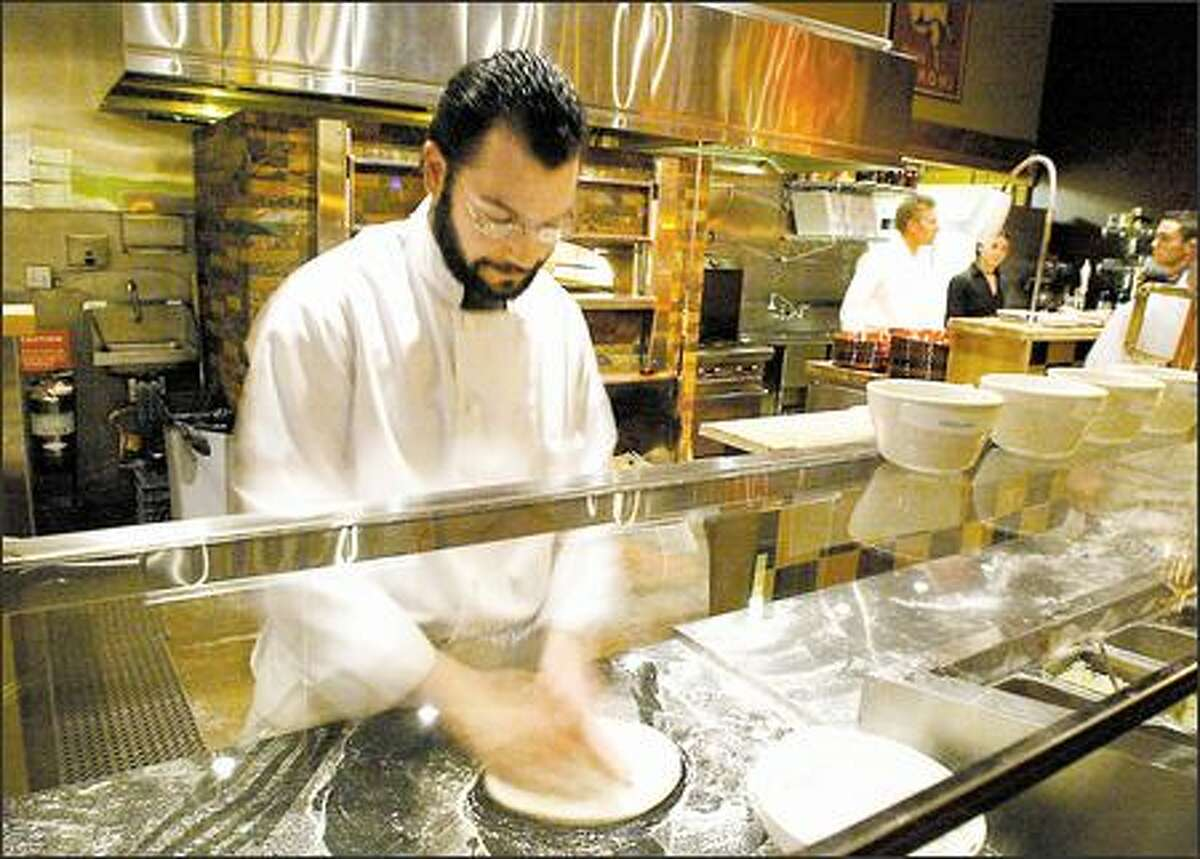 You don't have to go to Naples: Brian Gojdics works up an authentic Neapolitan pizza at Tutta Bella Neapolitan Pizzeria in Columbia City.