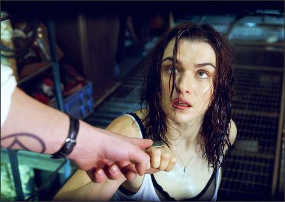 "RACHEL WEISZ stars in Warner Bros. Pictures' supernatural thriller ""Constantine,"" also starring Keanu Reeves. PHOTOGRAPHS TO BE USED SOLELY FOR ADVERTISING, PROMOTION, PUBLICITY OR REVIEWS OF THIS SPECIFIC MOTION PICTURE AND TO REMAIN THE PROPERTY OF THE STUDIO. NOT FOR SALE OR REDISTRIBUTION. Photo: Warner Brothers / Warner Brothers"