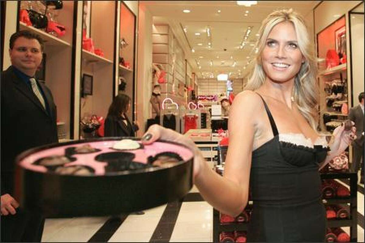 Tuesday, in case you've missed the message all over hill and dale, is the day for sweets for your sweetie. But chances are that your sweetie, however beloved, is not any more fetching than luscious model Heidi Klum, who puts a box of chocolates to shame during an appearance at the Victoria's Secret in NYC.
