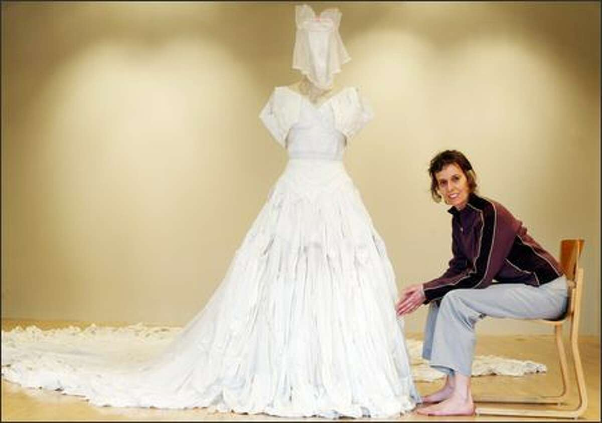 Port Townsend artist Nole Giulini poses with the wedding dress she created from used men's and women's underwear. Check out more images at www.ngiulini.com.