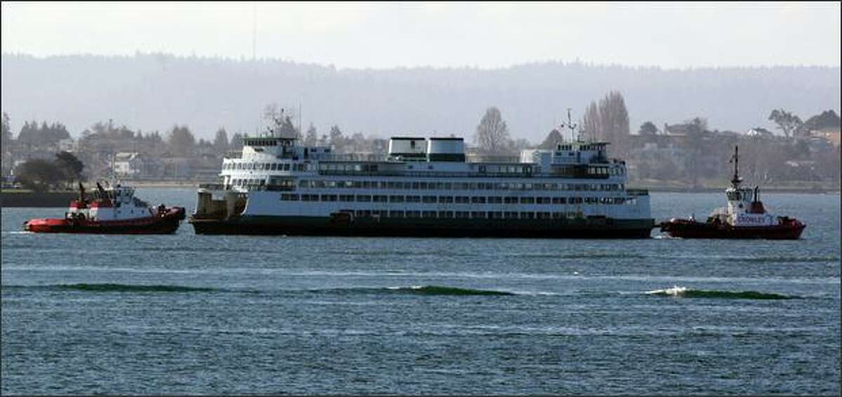 The Hyak is taken from Seattle by tugboat Wednesday after developing mechanical problems.