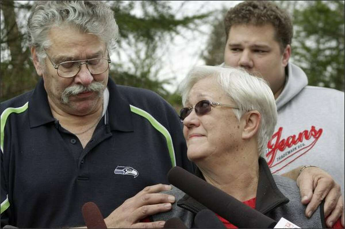 Jim and Lynn Morris, parents of Rebecca Shaw, talk to the media about their daughter outside their Maple Valley home on Friday. In the background is Shaw's brother Billy Morris. Shaw, 24, was the first officer on Flight 3407, the Colgan Air flight that crashed Thursday nigth in suburban Buffalo, killing all 49 aboard and one person on the ground.