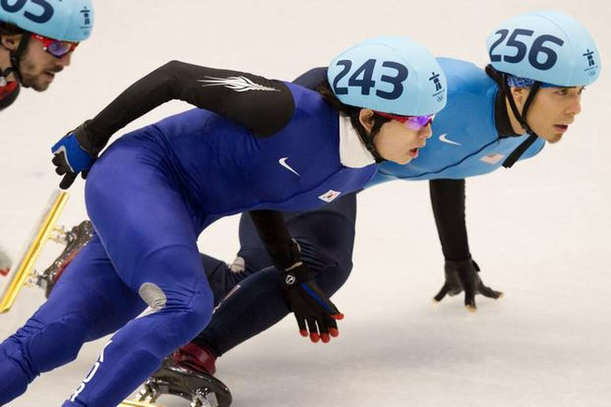 Apolo Anton Ohno of the USA tries to get past Jung-Su Lee, 243, of Korea during the mens' 1,500-meter semifinals in short track speed skating at the Pacific Coliseum on Saturday.