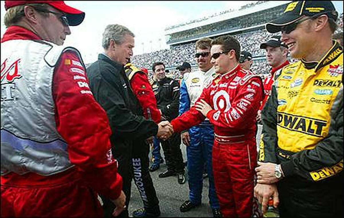 President Bush shakes hands with Casey Mears (center) as Sterling Marlin (left) and Matt Kenseth (right) look on at Daytona 500 NASCAR race Sunday, Feb. 15, 2004, in Daytona Beach, Fla. (AP Photo/Pablo Martinez Monsivais)