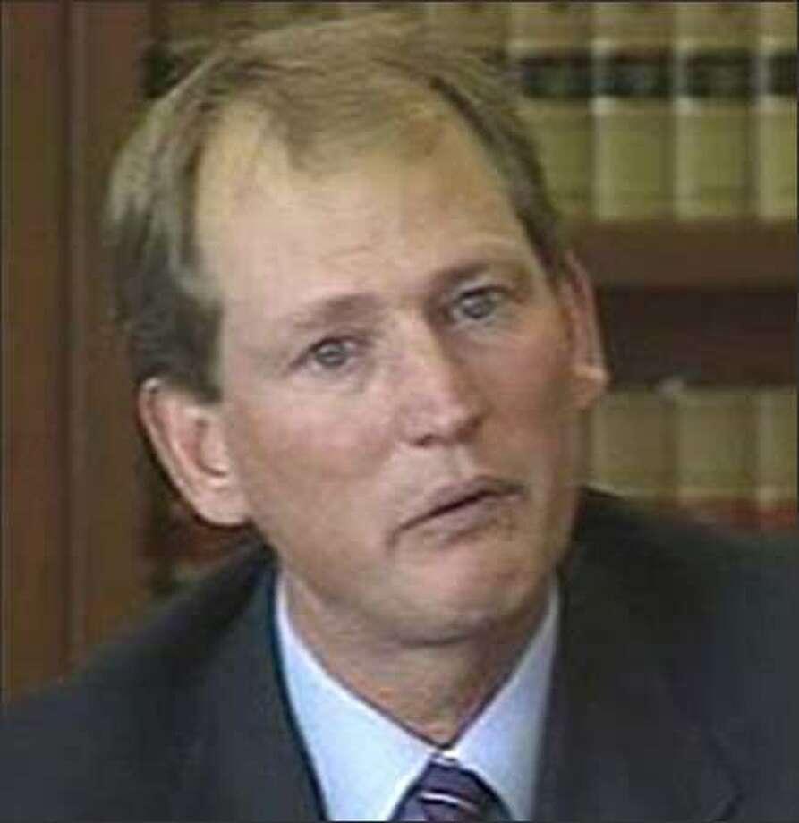 Former UW Coach Rick Neuheisel cries on the witness stand; photo taken from video. Photo: KOMO-TV/4 / KOMO-TV/4
