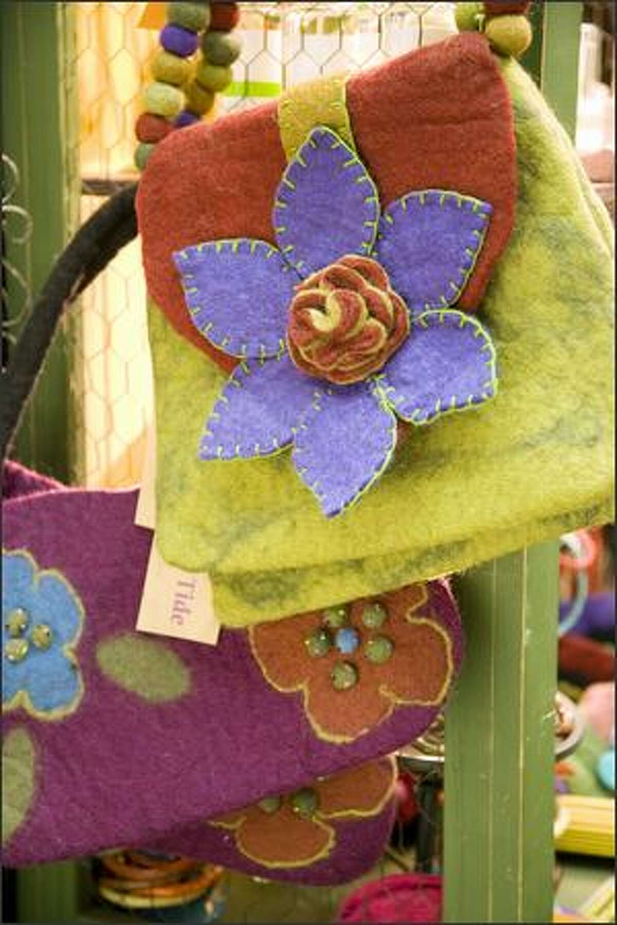 Fremont Gardens offers seeds, plants, felted wool purses and knickknacks at reasonable prices at booth 104.