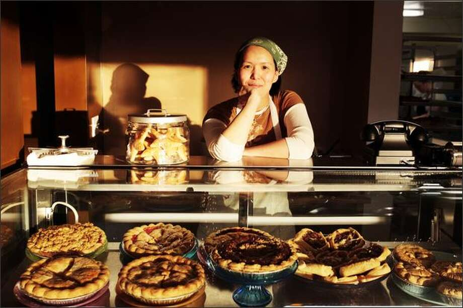 Kimmy Tomlinson, a former financial analyst who opened Shoofly Pie last summer, is doing a booming business. She's a butter believer, producing flaky, flavorful crusts. Photo: Meryl Schenker, Seattle Post-Intelligencer / Seattle Post-Intelligencer